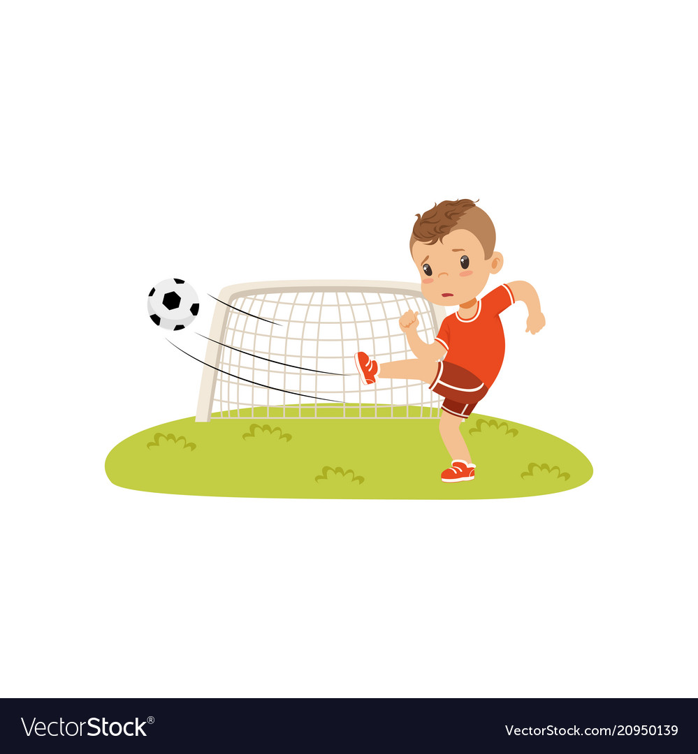 Boy with soccer ball doing kick on the lawn sad