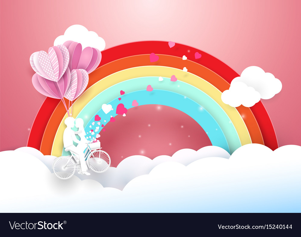 Sweet couple on bicycle flying with rainbow