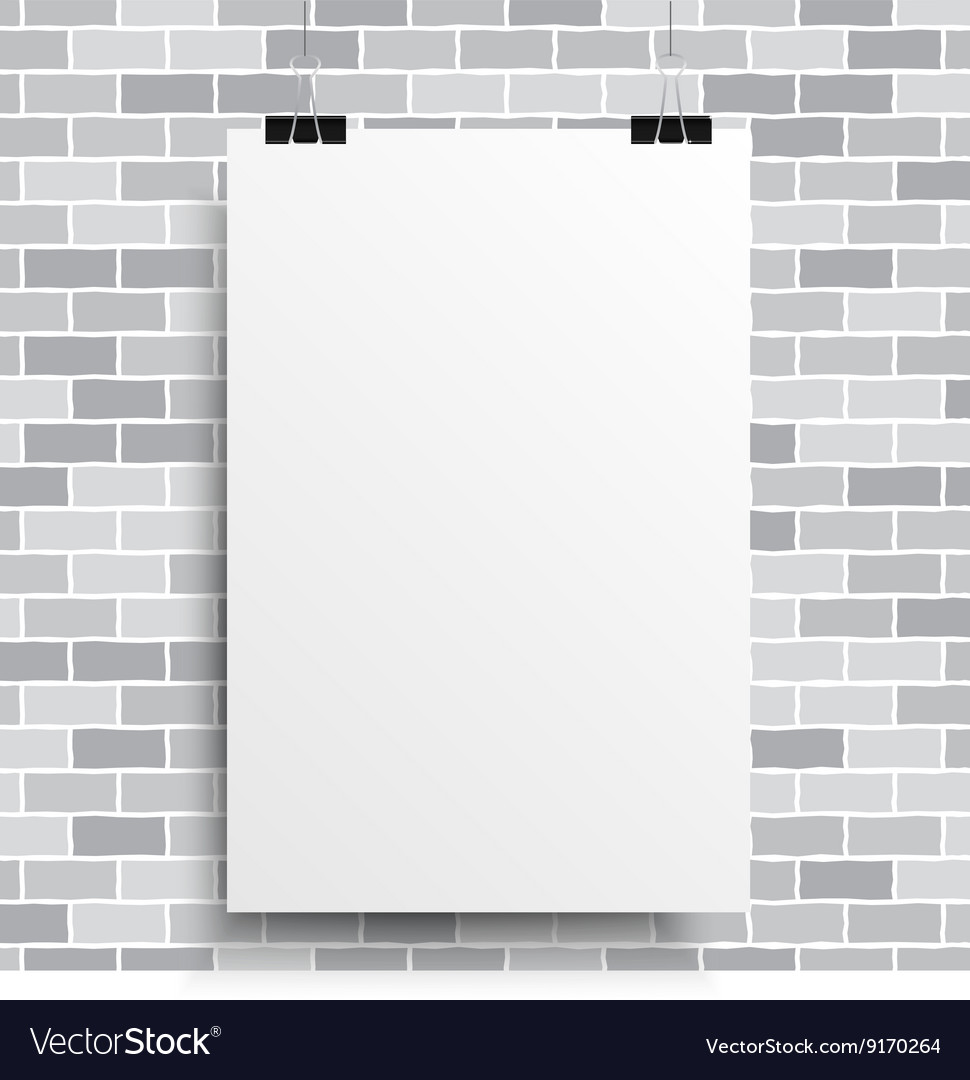 A white poster on a grey wall