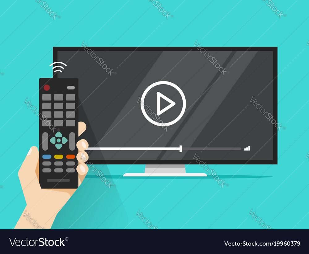Remote control in hand near flat screen tv