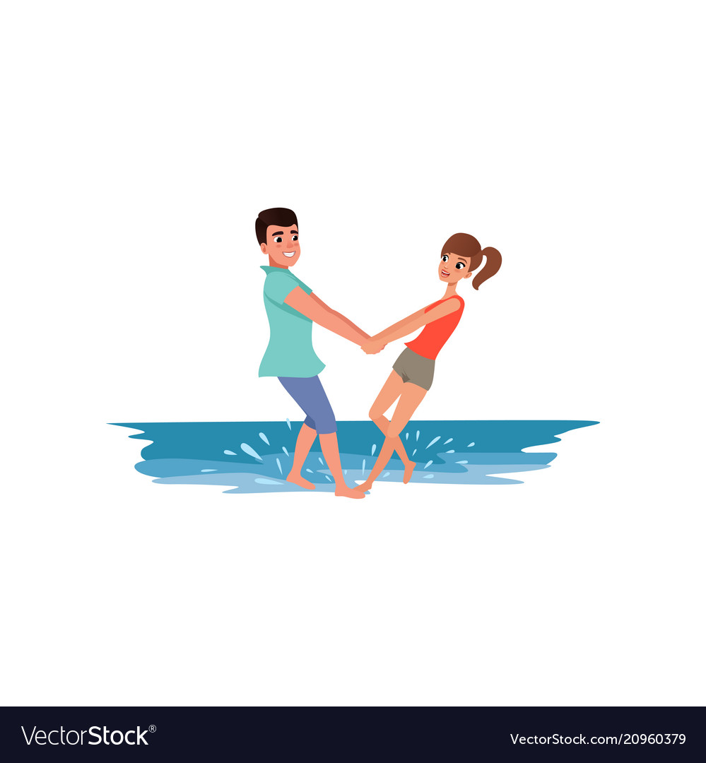 Romantic couple standing in the sea holding hands vector image