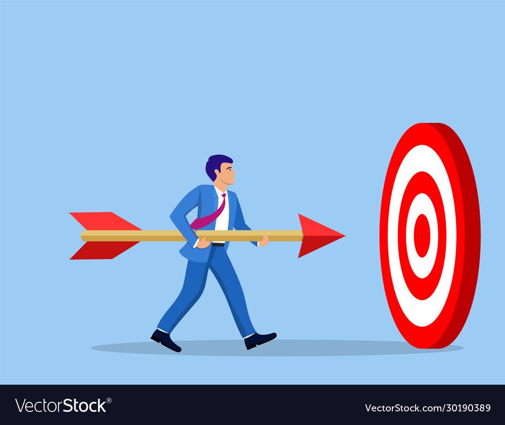 Businessman aim arrow to target