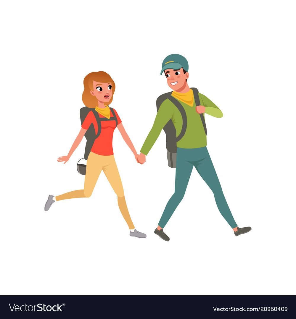 Young couple walking with backpacks man and woman