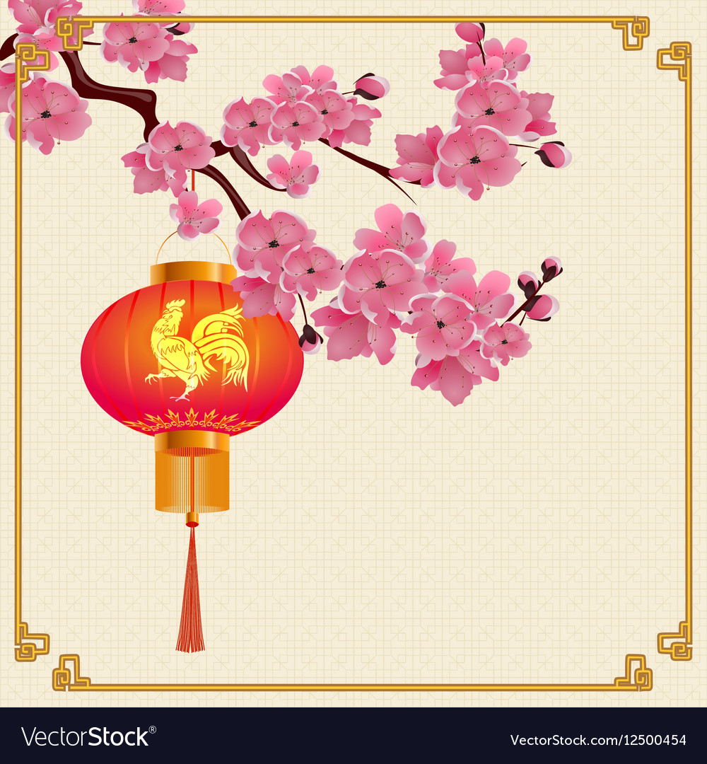 Red Chinese lanterns hanging on a branch of cherry