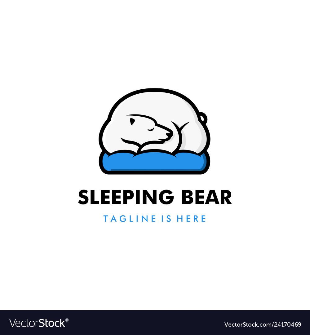 Lazy sleeping white polar bear in blue pillow