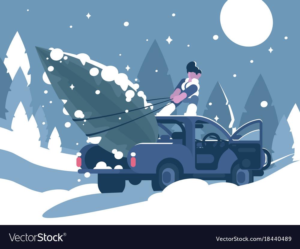 Man loading christmas tree in car