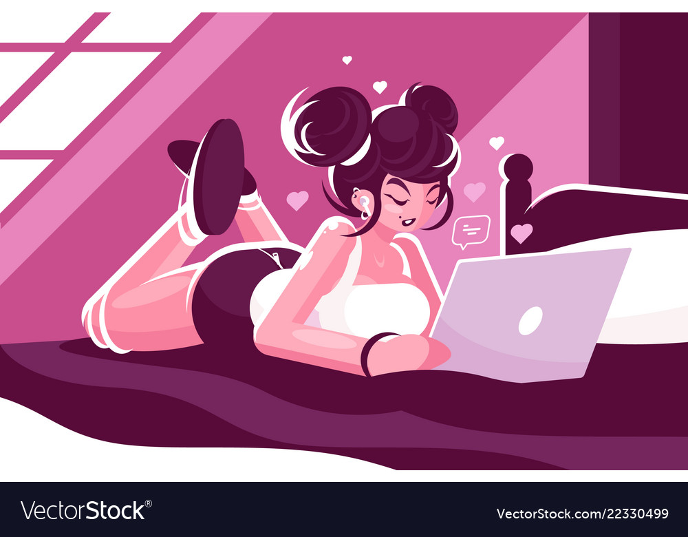 Woman lies on bed and using laptop