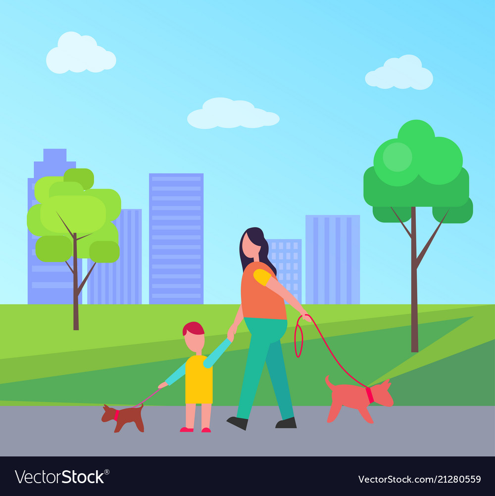 Mother and son walking little dogs