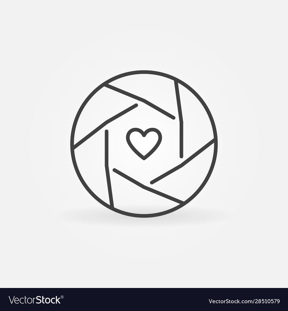 Heart inside camera shutter outline concept