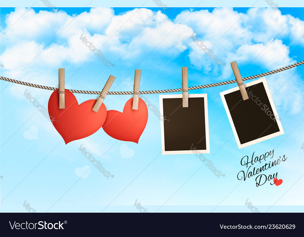 Holiday background with a red paper hearts and