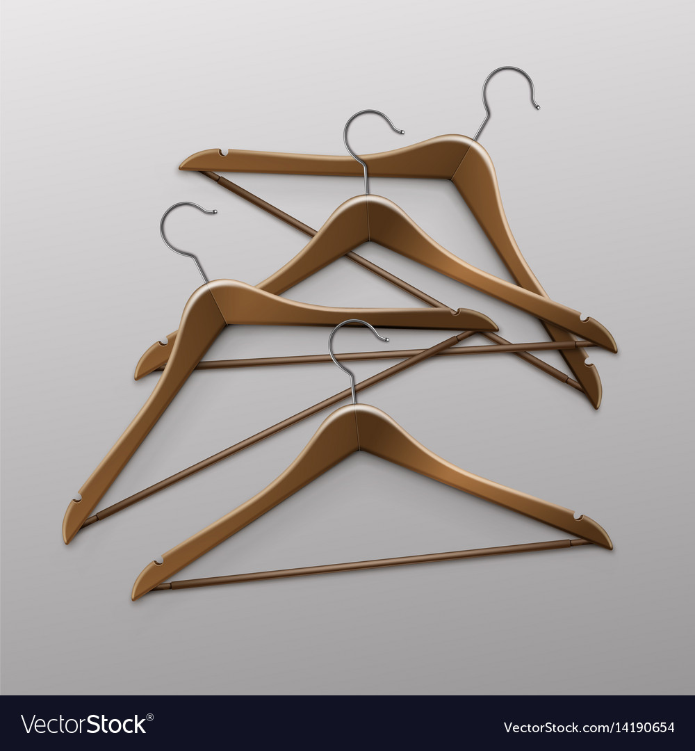 Pile of lying clothes coat brown wooden hangers