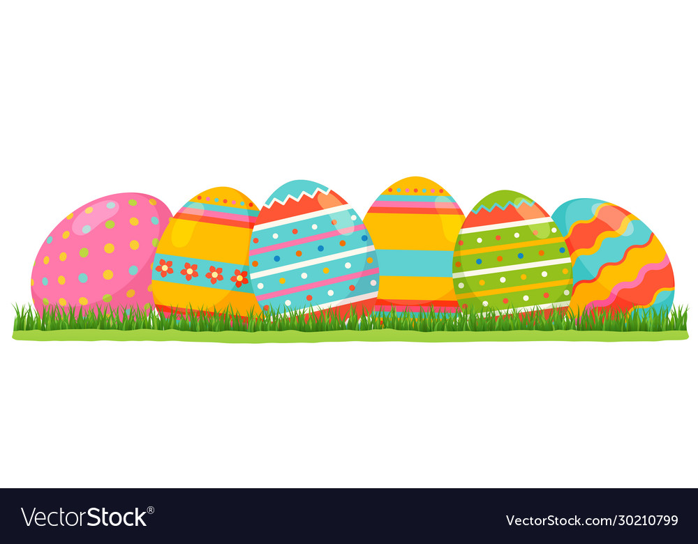 Easter colored eggs with pattern on green grass
