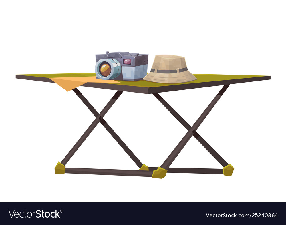 Tourist table with camera and hat isolated on