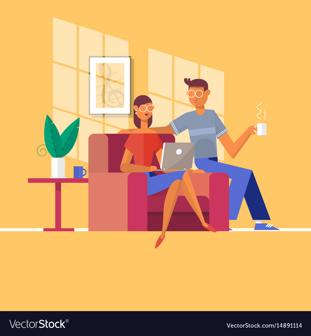 Young couple relaxing on the couch with laptop in