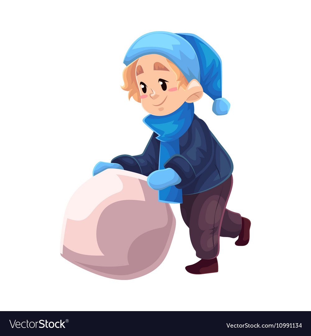 Little boy in winter clothes making a snowman