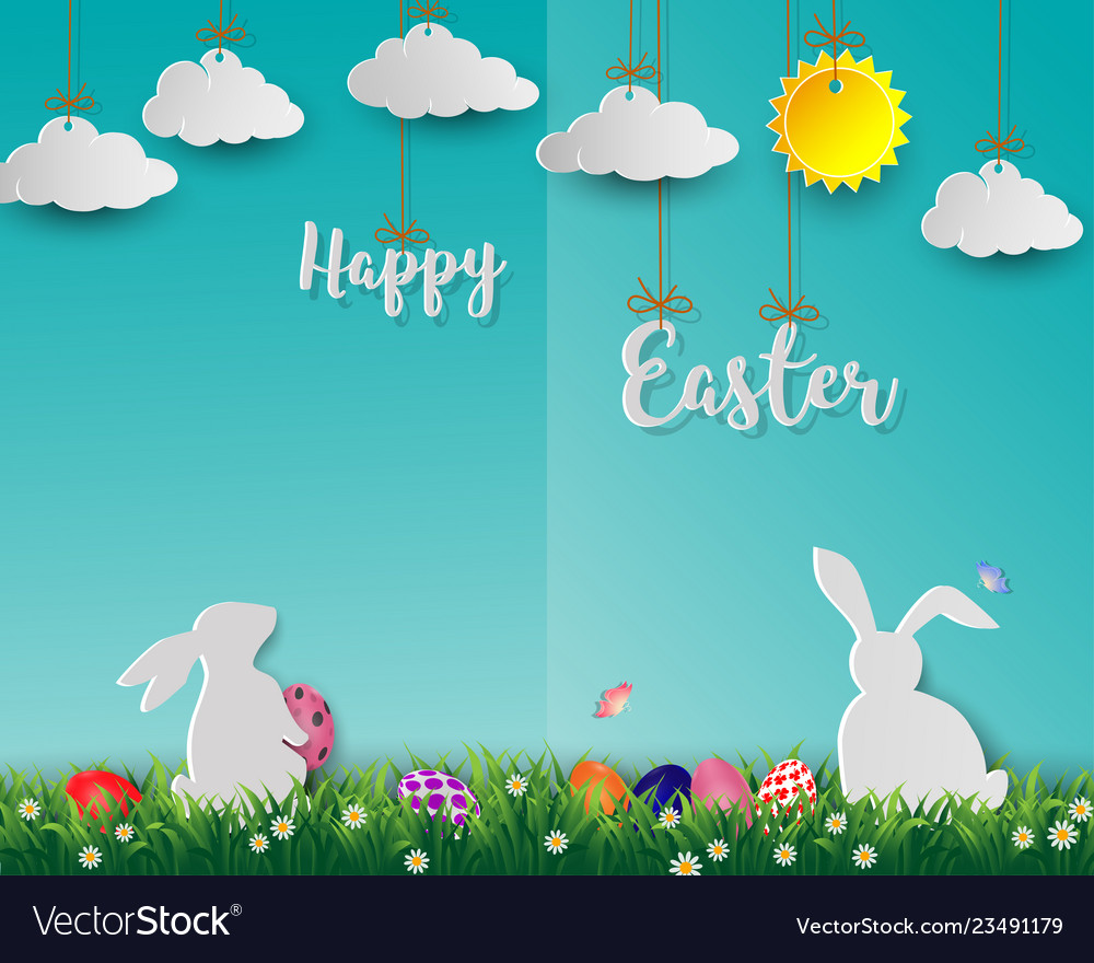 Easter eggs with white rabbits on green grass