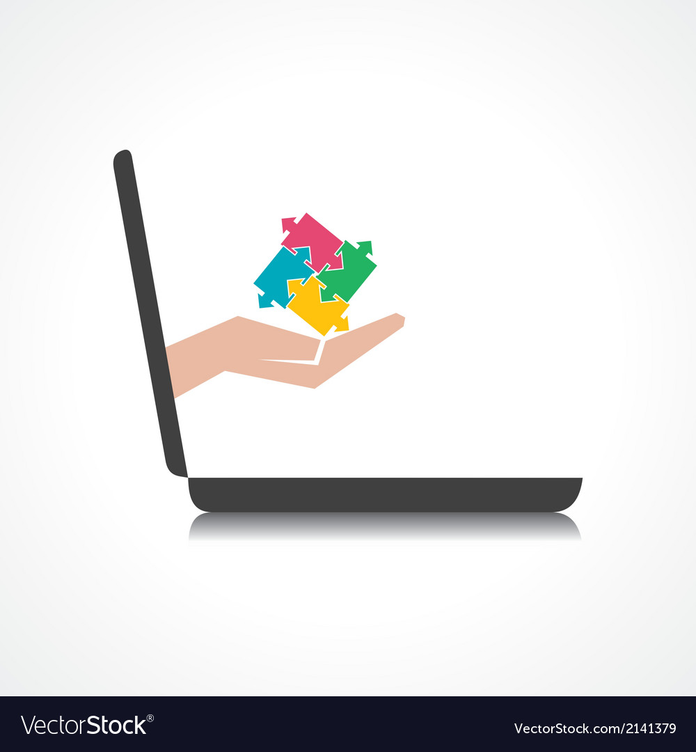 Hand holding puzzle piece comes from laptop screen