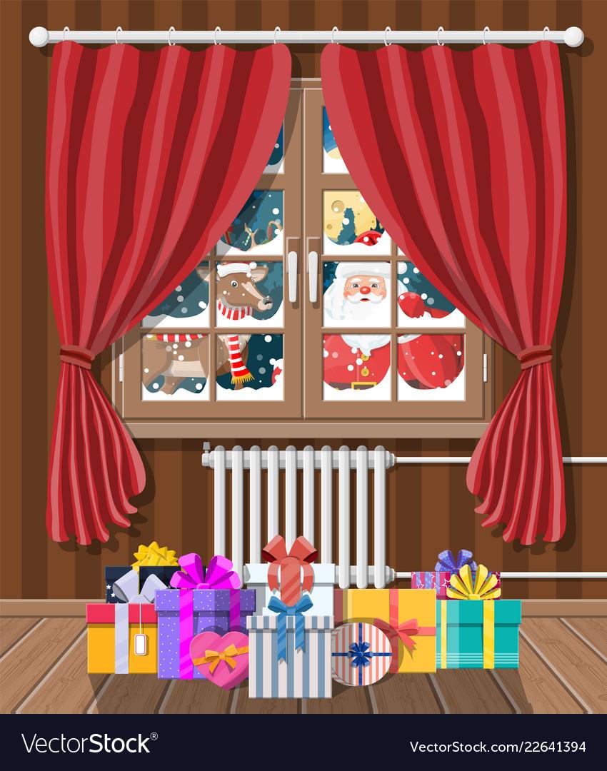 Santa claus and his reindeer looks in room window