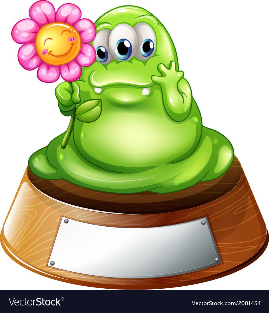 A green monster holding a flower