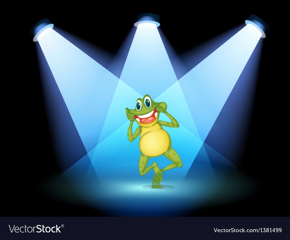 A frog smiling in the middle of the stage