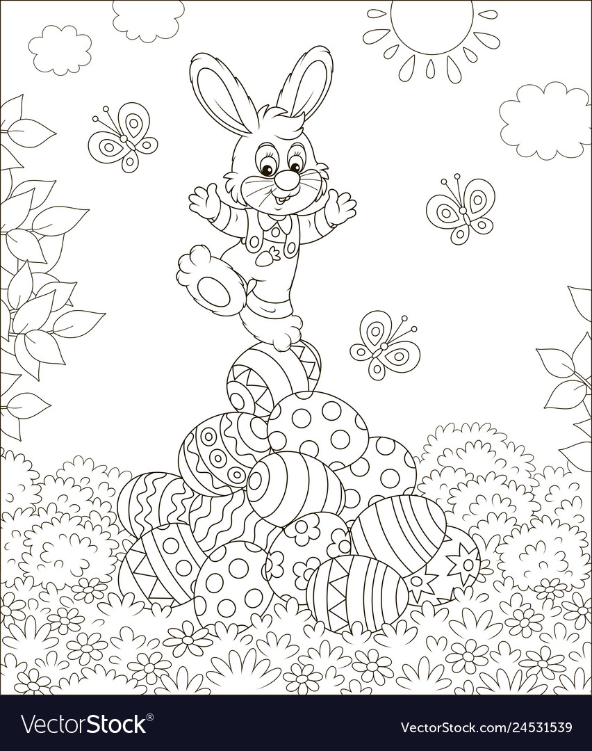 Little easter bunny on a pile of decorated eggs