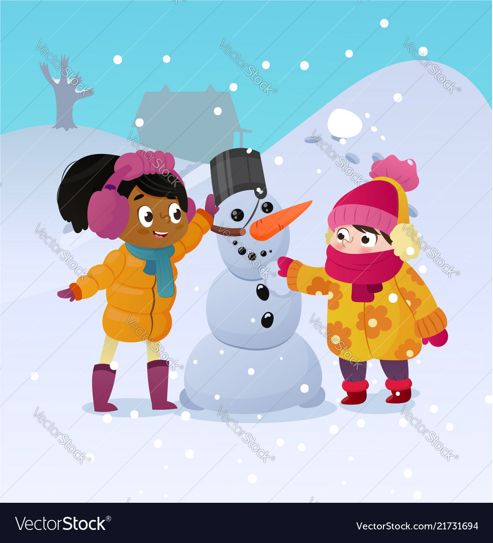 Happy kids playing with snowman funny little girs