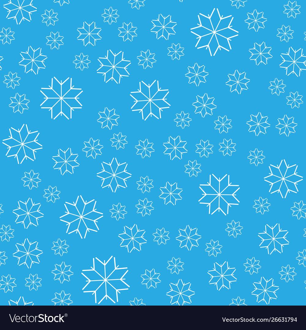 Seamless pattern white snowflakes on a blue