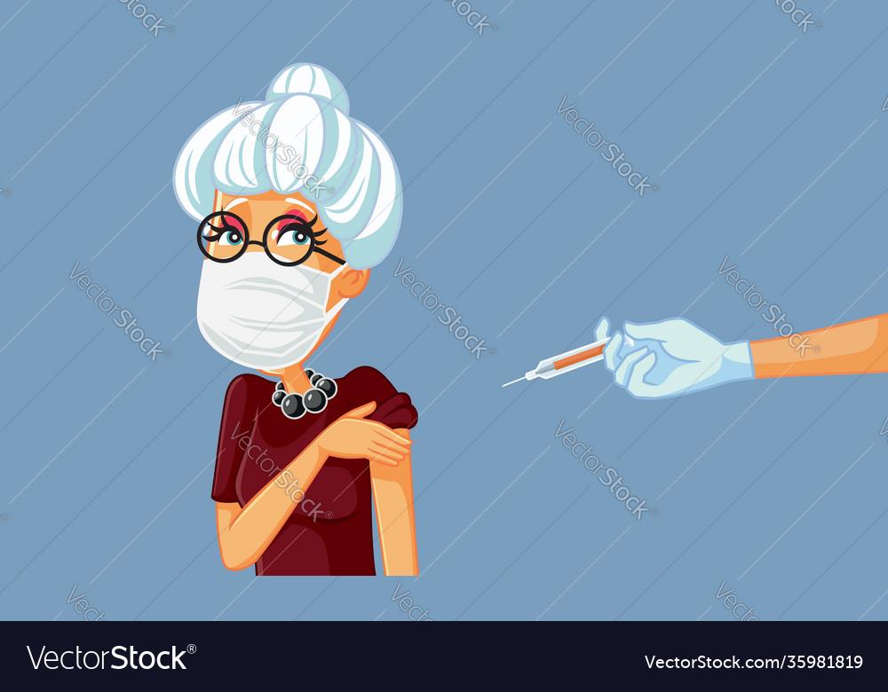 Senior woman wearing medical mask getting a