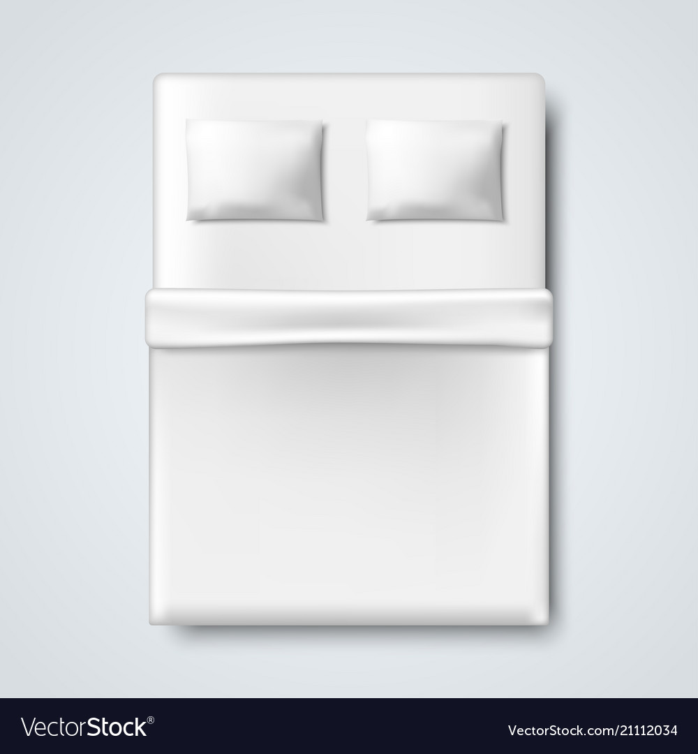 White bed with pillow and blanket