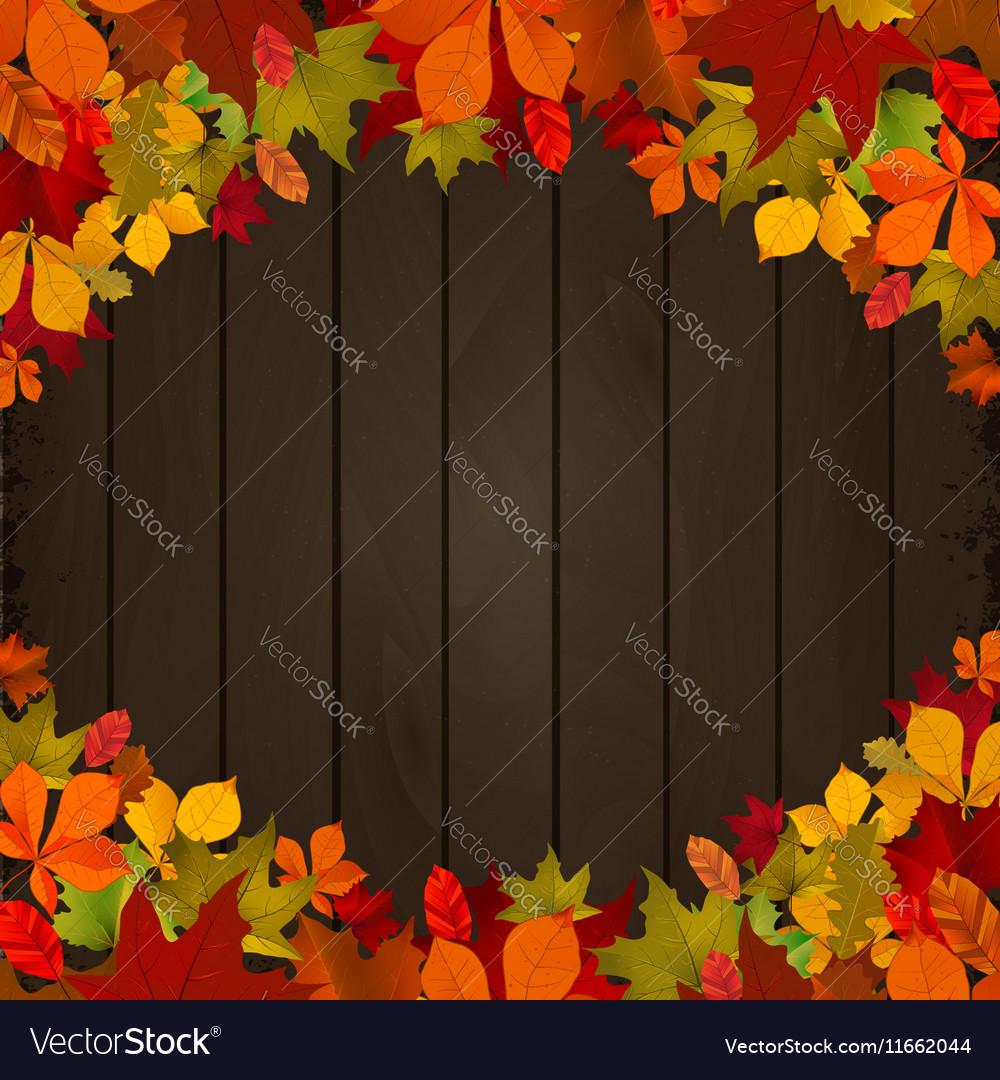 Autumn leaves on dark wooden background Design