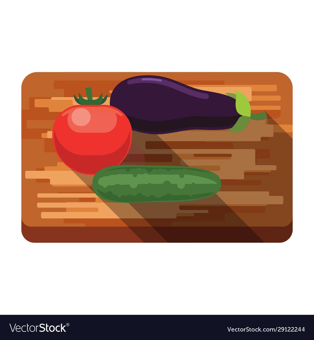 Fresh eggplant tomato cucumber on a cutting