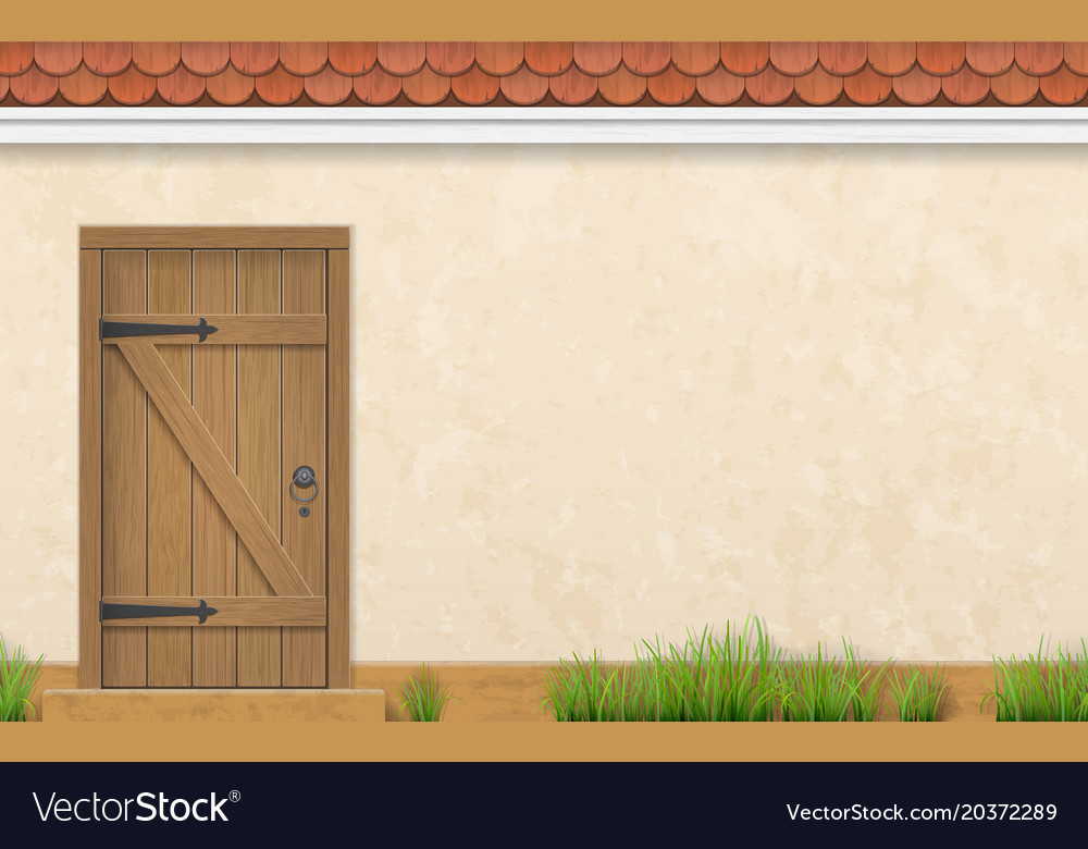 Facade with old wooden door grass