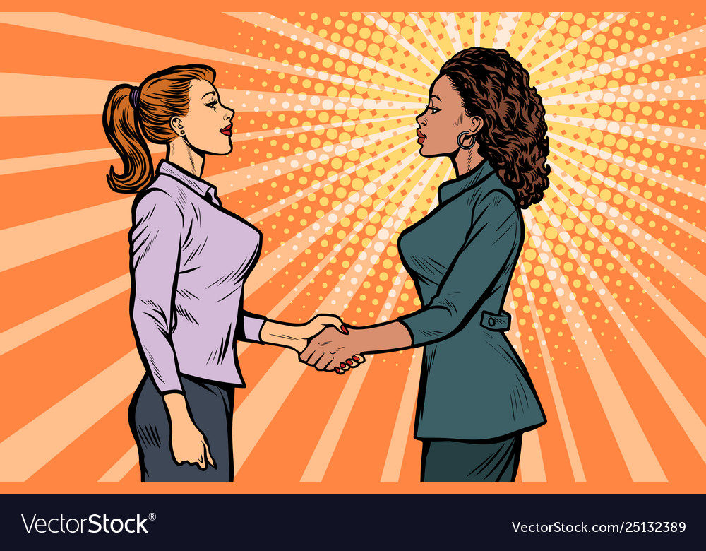 African and caucasian businesswomen shaking hands