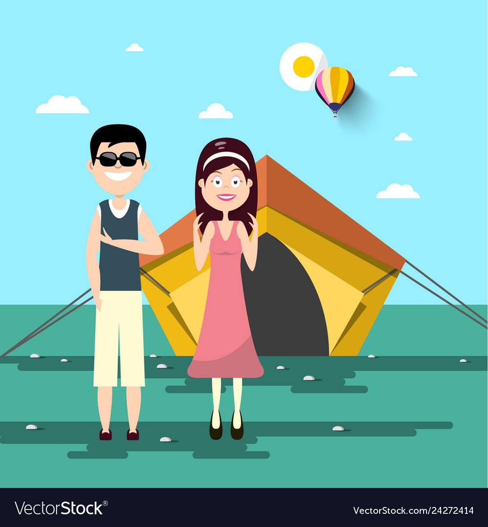 Couple on camping trip with tent and landscape on