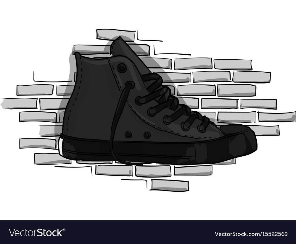 Drak gray sneakers on a background of a gray brick