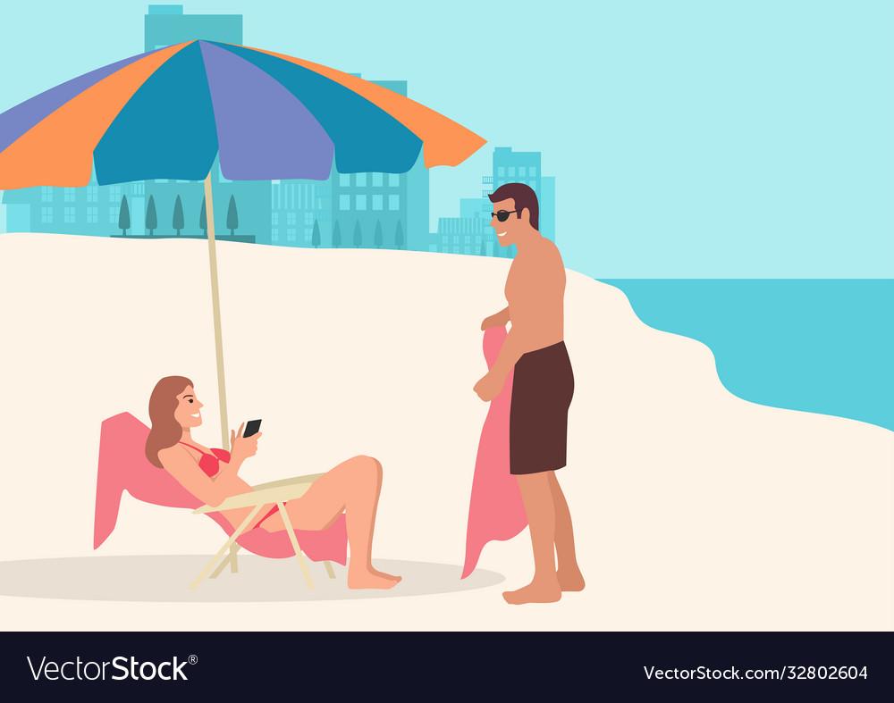 Couple taking sunbath on beach