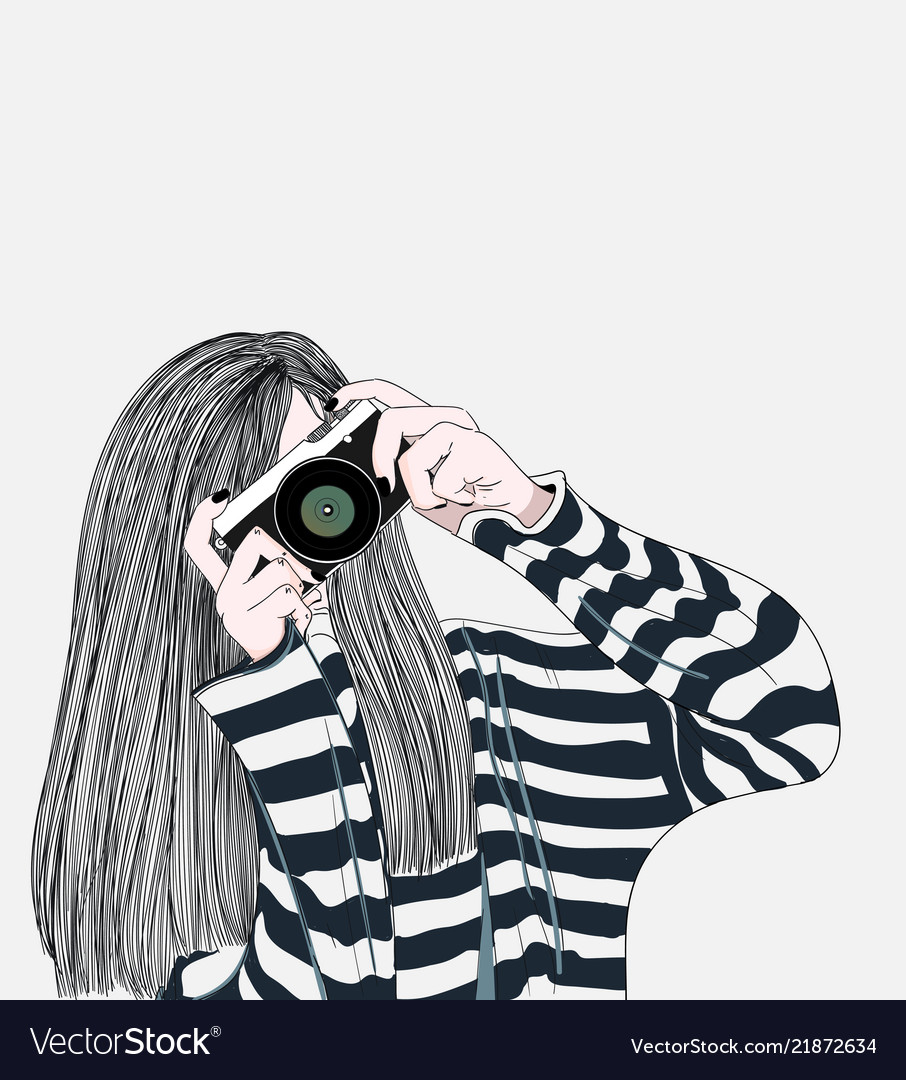 The girl holding a stylish camera