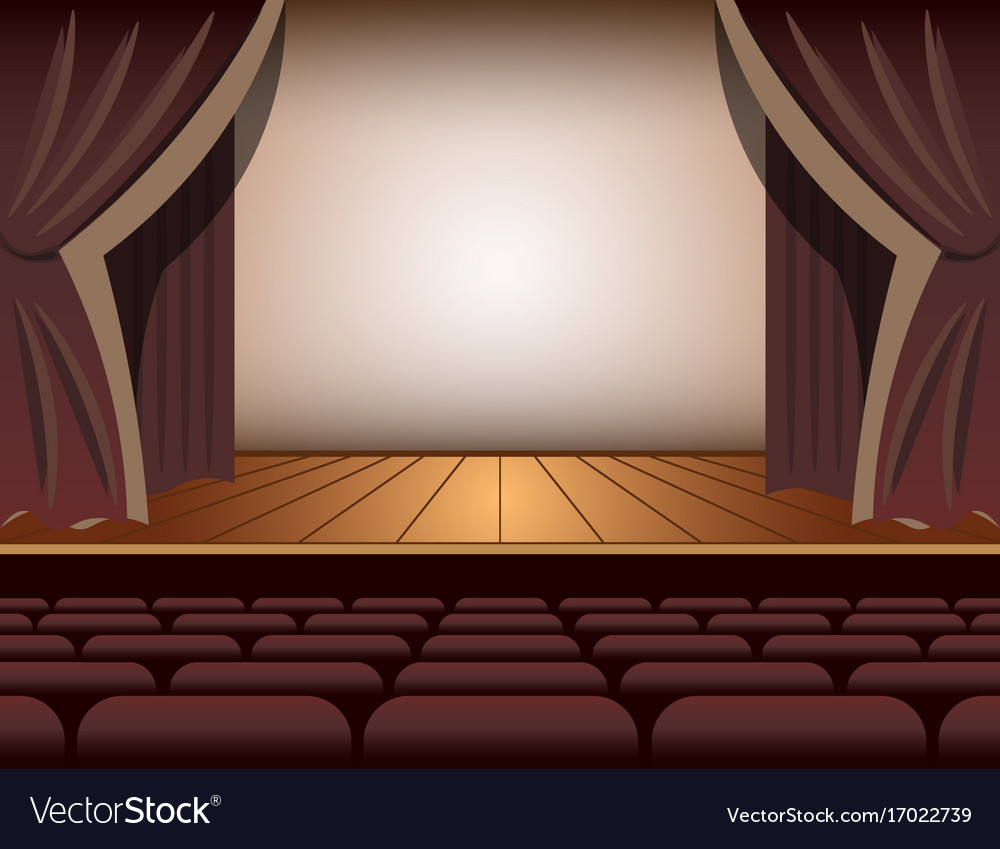 A theater stage with a curtain and seats