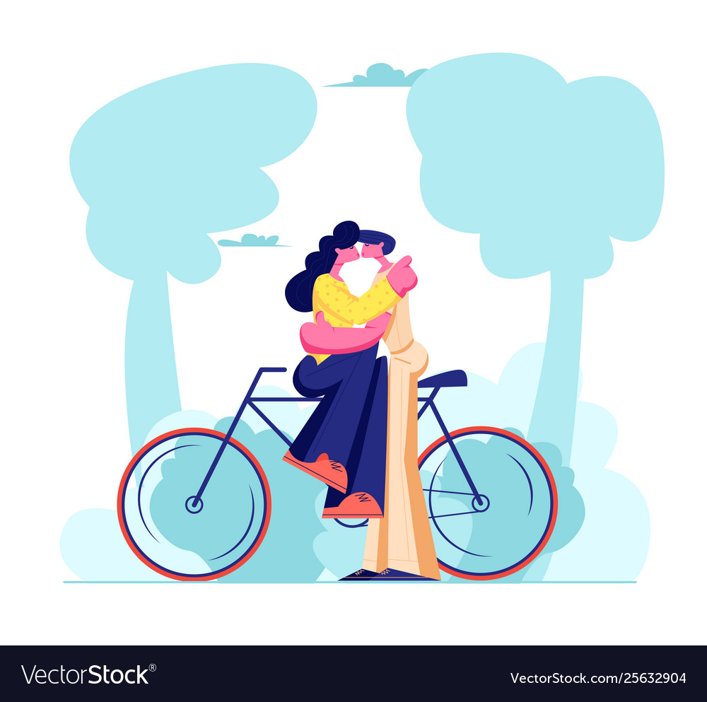 Young loving couple sitting on bicycle and kissing