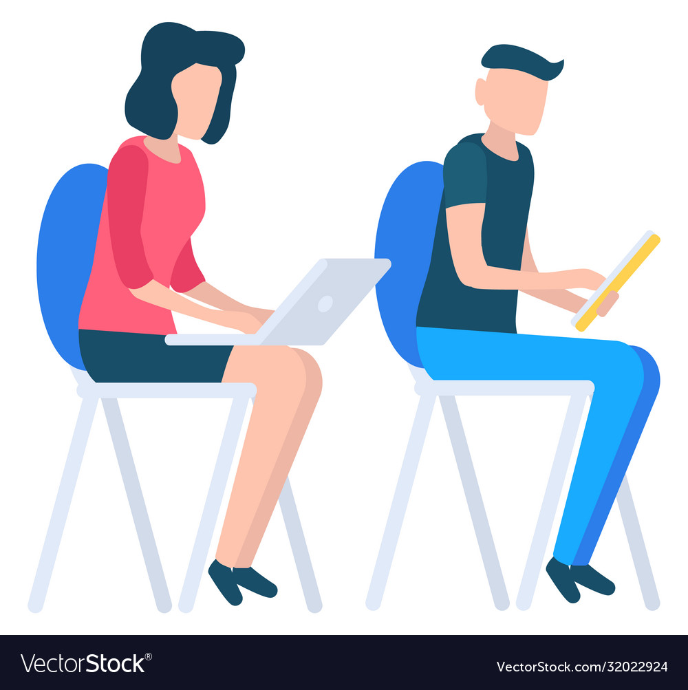 Man with tablet and woman with laptop working