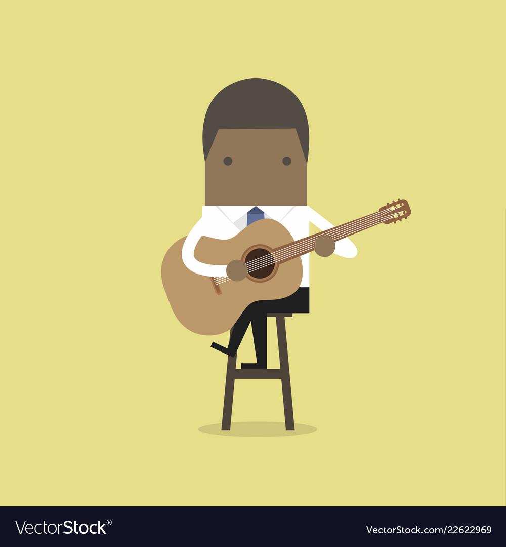 African businessman playing guitar