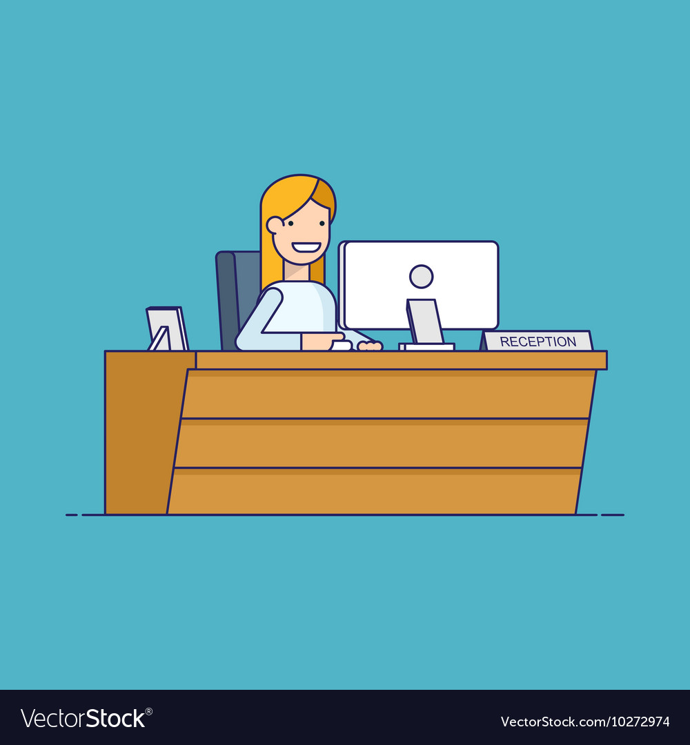 Smiling secretary sitting at a computer in the