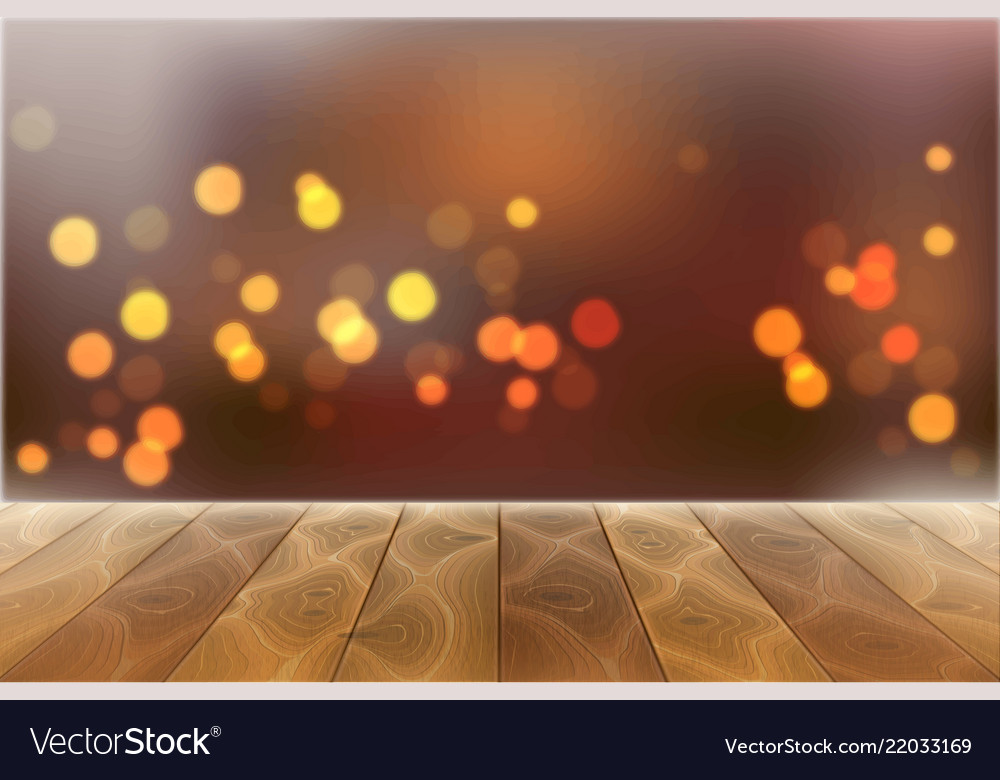 Wooden table on blurred bokeh lights