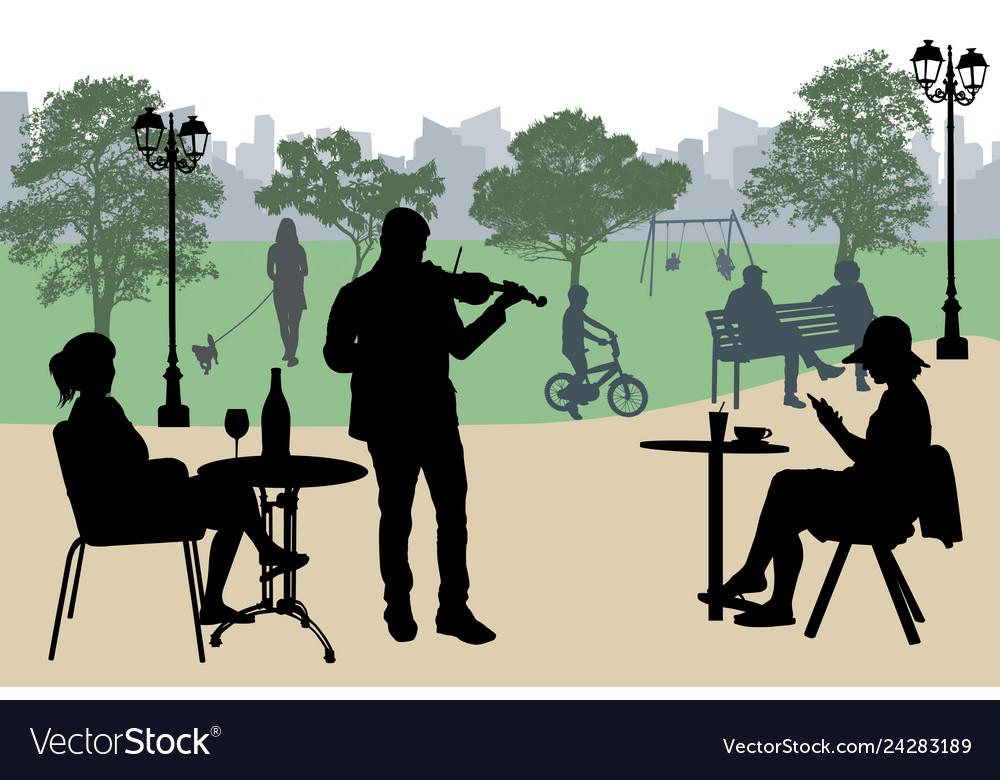 Violinist perform on a street cafe near city park