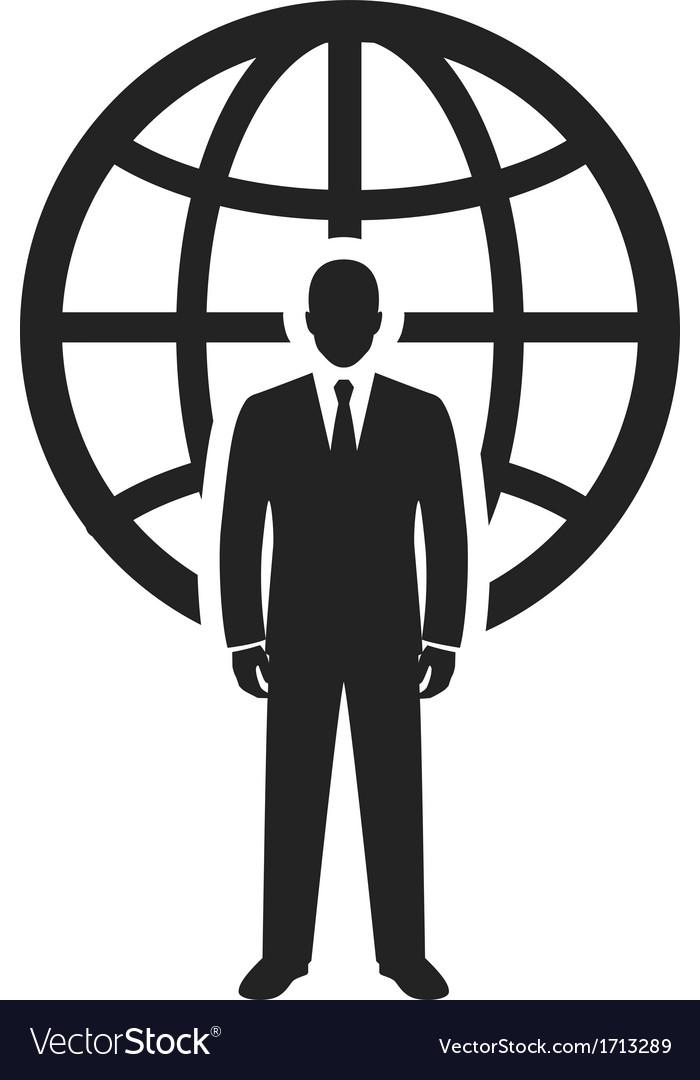 Businessman standing near globe