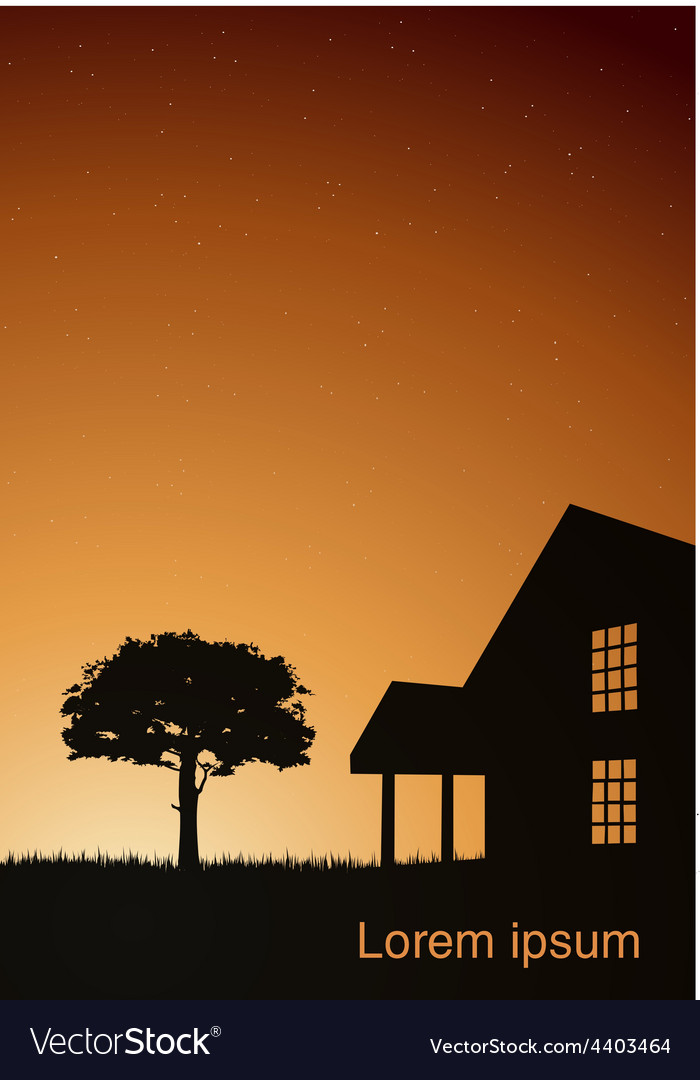 A house with a tree at sunset
