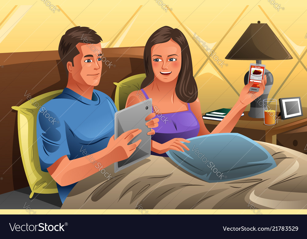 Couple using technology on the bed