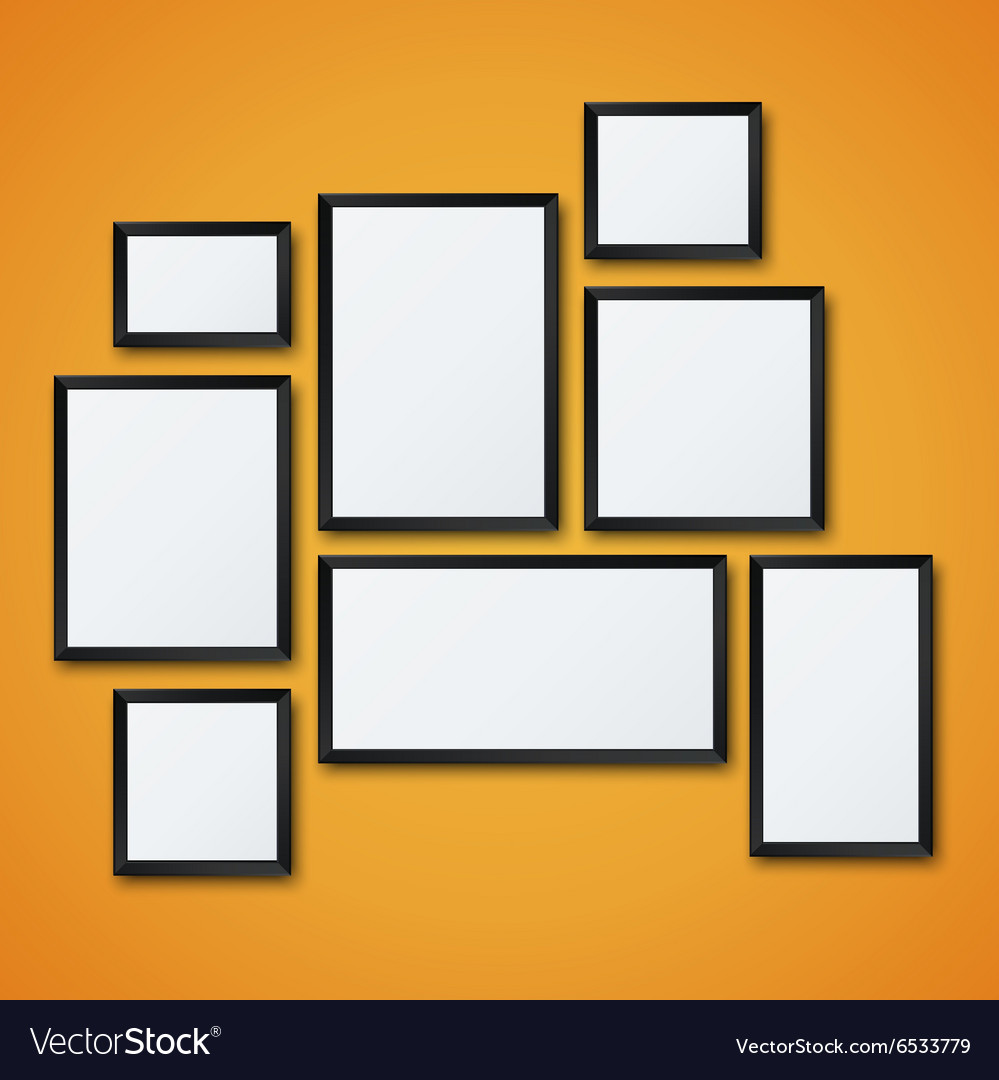 Blank picture frame set on orange wall