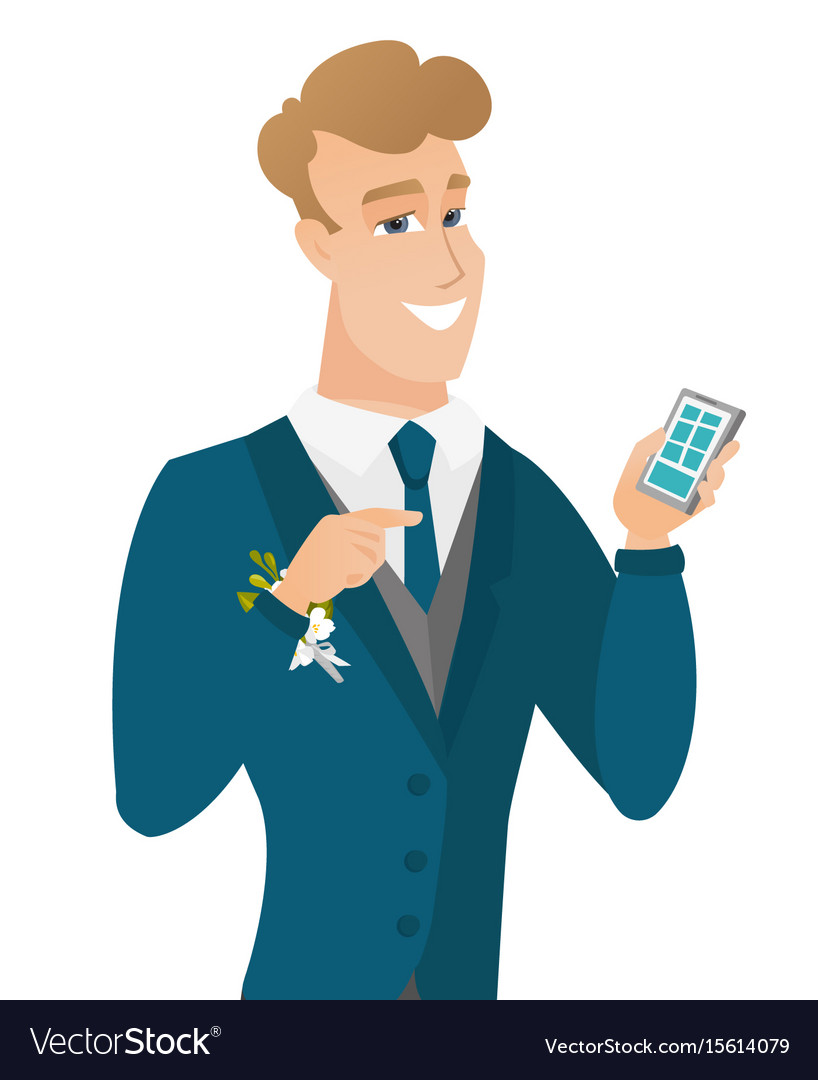 Young caucasian groom holding a mobile phone