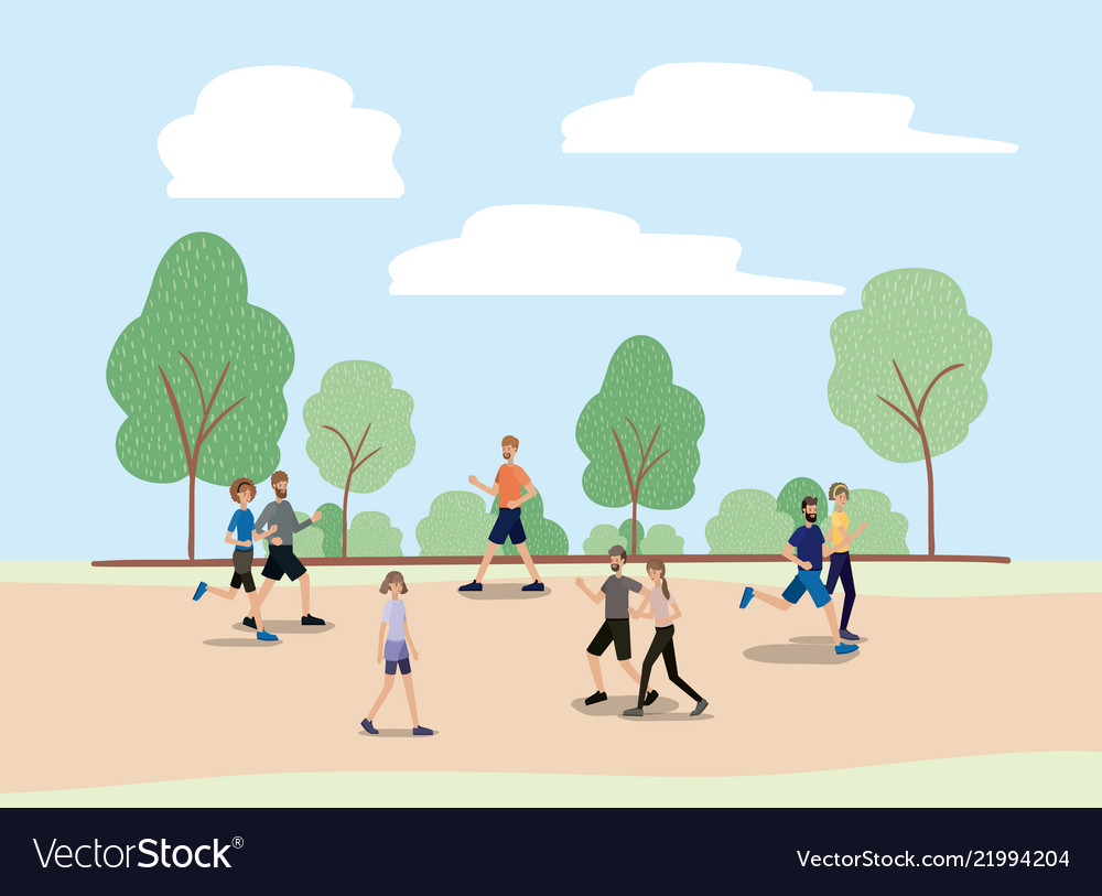 Group of people walking and running on the park